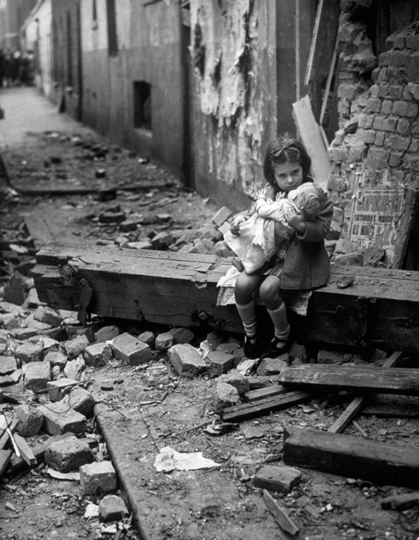 Girl With Dolly After WWII Air Raid