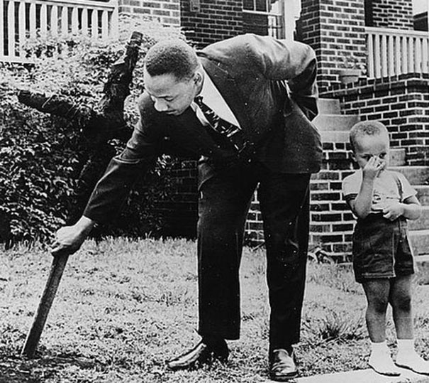 MLK Removing Burnt Cross With Son From Yard